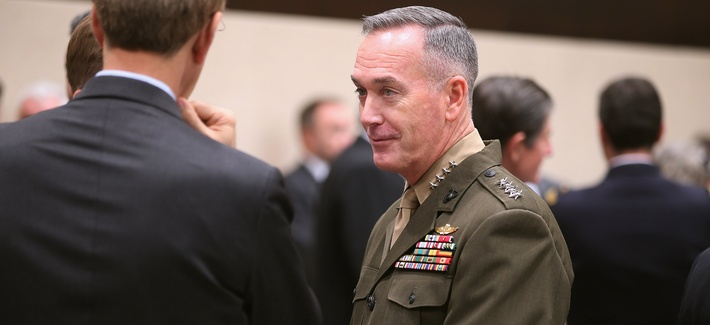 Top ISAF Commander Gen. Joseph Dunford speaks with delegates at a NATO Defense Ministers Meeting on February 23, 2013.