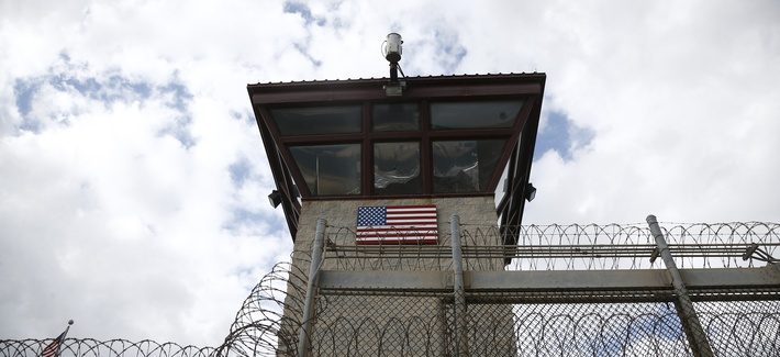 A photo of a guard tower at the entrance to the Camp VI facility at Guantanamo Bay Naval Base, taken on November 19, 2013.