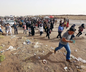 Refugees flee from Mosul to the self-ruled northern Kurdish region of Irbil, Iraq, on June 12, 2014.