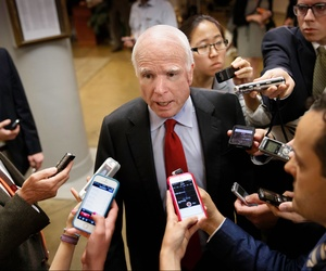 Sen. John McCain, R-Ariz., speaks to reporters during a press conference on Capitol Hill on June 4, 2014.