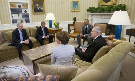 President Barack Obama meets with Senate Minority Leader Mitch McConnell of Ky., House Speaker John Boehner of Ohio, Senate Majority Leader Harry Reid of Nev., and House Minority Leader Nancy Pelosi of Calif., in the Oval Office on June 18, 2014.
