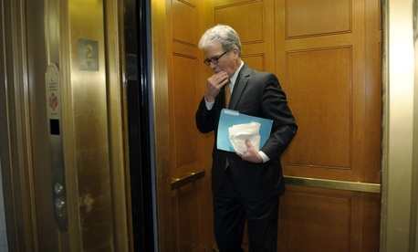 Sen. Tom Coburn, R-Okla., walks into an elevator after a meeting on Capitol Hill, on December 31, 2012.