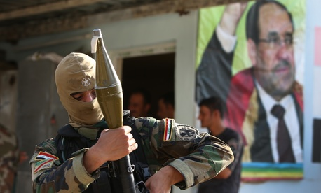 An Iraqi Shiite Turkmen gunman in the village of Taza Khormato, in the oil rich province of Kirkuk, Iraq, on June 20, 2014.