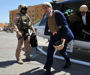 Secretary of State John Kerry steps off a helicopter after arriving at U.S. Embassy Baghdad for meetings with Iraqi government officials, on June 23, 2014.