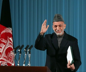 Afghan president Hamid Karzai waves at a cultural event in Kabul, Afghanistan, on May 15, 2014