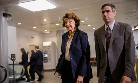 Senate Intelligence Committee Chair Sen. Dianne Feinstein, D-Calif., walks with a staff member to a closed door briefing with intelligence officials, on June 4, 2014.