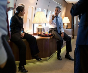 President Obama speaks with National Security Advisor Susan Rice aboard Air Force One on April 25, 2014.