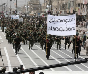 "Volunteers of the newly formed ""Peace Brigade"" march in a demonstration in Sadr City, Baghdad, Iraq, on June 21, 2014."