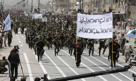 """Volunteers of the newly formed """"Peace Brigade"""" march in a demonstration in Sadr City, Baghdad, Iraq, on June 21, 2014."""