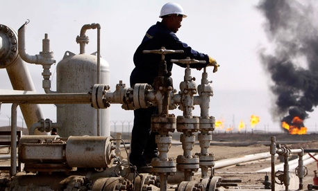 An Iraqi worker operates valves at the Rumaila oil refinery, near the city of Basra, Iraq, on Nov. 9, 2009. A 20-year contract signed by Iraq's Oil Ministy with China's CNPC, on Nov. 3, 2009, gives the company partial development rights for Rumaila field.