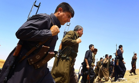 Kurdish Peshmerga security forces stand guard on the outskirts of the northern city of Mosul, Iraq, June. 14, 2014.