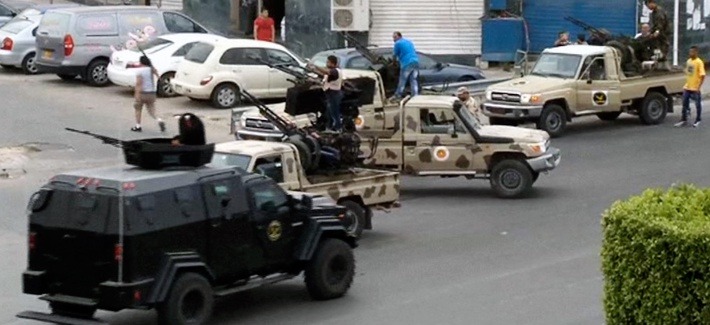 Tripoli joint security forces guard the entrance road to the parliament area after troops of Gen. Khalifa Hifter targeted Islamist lawmakers and officials at the parliament in Tripoli, Libya, in mid May.