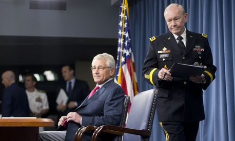 Joint Chiefs Chairman Gen. Martin Dempsey walks to his seat prior to a press briefing with reporters at the Pentagon on Thursday.
