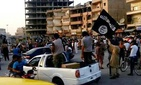 Fighters from the ISIL march during a parade in Raqqa, Syria, on June 30, 2014.