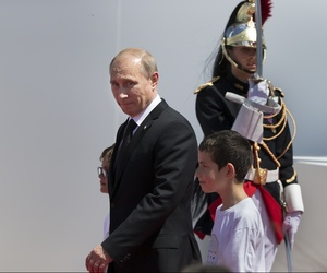 Russian President Vladimir Putin arrives for a ceremony commemorating the 70th anniversary of D-Day in Ouistreham, France, on June 6, 2014.
