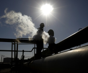 A Libyan oil worker works at a refinery inside the Brega oil complex in eastern Libya, on April 6, 2014.