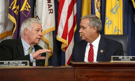 Rep. Jeff Miller, R-Fla., speaks to Rep. Mike Michaud, D-Maine, as the panel holds a hearing on the crisis at VA facilities, on June 9, 2014.