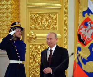 Russian President Vladimir Putin enters a hall for a ceremony to honor the Russian national ice hockey team, on May 27, 2014.