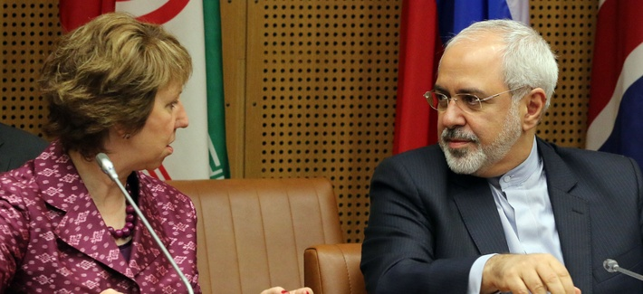 EU foreign policy chief Catherine Ashton and Iran's foreign minister Javad Zarif wait for the start of closed door negotiations in Vienna, Austria, on July 3, 2014.