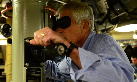 Defense Secretary Chuck Hagel tries the periscope aboard the Ohio-class nuclear submarine USS Tennessee at Submarine Base Kings Bay, Ga. Jul. 9, 2014.