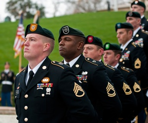 Special Forces Green Beret soldiers from each of the Army's seven Special Forces Groups stand silent watch during the wreath-laying ceremony at the grave of President John F. Kennedy, Nov. 17, 2011, at Arlington National Cemetery.