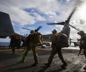 Marines with the 6th Marine Regiment, 22nd Marine Expeditionary Unit load onto an MV-22 Osprey aboard the USS Bataan before an exercise in Greece, on March 7, 2014.