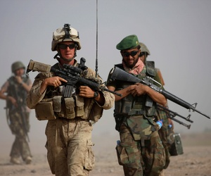 A U.S. Marine with Bravo Company, 1st Battalion 5th Marines walks with Afghan National Army officer during in a joint patrol in Nawa district, Helmand province, southern Afghanistan, Oct. 3, 2009.