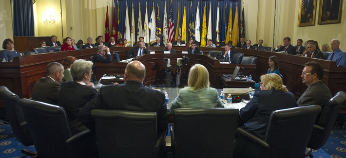 A panel of witnesses from the Veterans Affairs Department testify before the House Veterans Affairs Committee, on July 14 2014.
