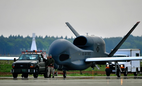 An RQ-4 Global Hawk from Andersen Air Force Base, Guam is towed down the taxiway at Misawa Air Base, Japan, May 24, 2014.