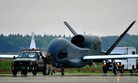 An RQ-4 Global Hawk from Andersen Air Force Base, Guam is towed down the taxiway at Misawa Air Base, Japan, May 24, 2014.