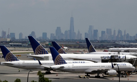 United Airlines jets remain parked on the tarmac at Newark International Airport, on July 22, 2014.