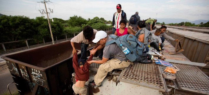 Central American migrants board a northbound freight train in Ixtepec, Mexico.
