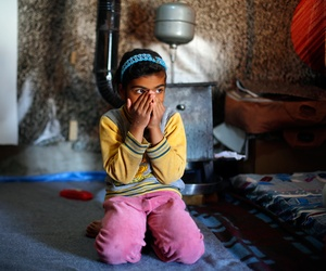 Sedra, 7, sits in her tent in the Fayda Camp, 25 miles east of Beirut on March 10, 2014. She and her 3 year old sister Gena and her parents fled a Damascus suburb 15 days ago, after a bomb exploded close to their home while they were sleeping.