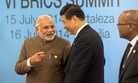India's Prime Minister Narendra Modi meets with China's President Xi Jinping at a BRICS summit in Fortaleza, Brazil.