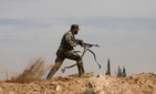 An Iraqi Shiite fighter clashes with members of the Sunni Free Syrian Army in Hatita, on N