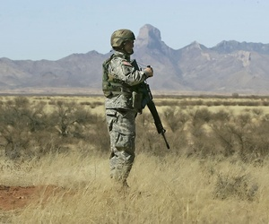 A Tennessee National Guardsman stands watch near the Arizona-Mexico border in Sasabe, Ariz., March 1, 2007.