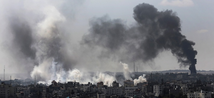 Smoke from Israeli strikes rise over northern Gaza Strip, Sunday, July 27, 2014. Israel resumed its Gaza offensive on Sunday, calling off a unilateral extension of a cease-fire after Palestinian militants fired several rockets at southern Israel.