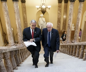 Senate Veterans' Affairs Committee Chairman Sen. Bernie Sanders, I-Vt., right and House Veterans' Affairs Committee Chairman Rep. Jeff Miller, R-Fla., head to a news conference on Capitol Hill on Monday.
