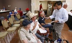 A VA official helps out two vets at a crisis center set up by the American Legion in Phoenix, on June 10, 2014.