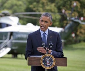 President Barack Obama announces new economic sanctions against parts of the Russian economy during a press conference on the South Lawn of the White House.