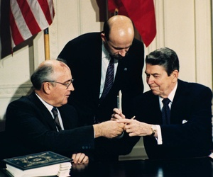 President Reagan signs the Intermediate Range Nuclear Forces Treaty with Soviet Premier Mikhail Gorbachev.