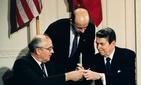 President Reagan signs the Intermediate Range Nuclear Forces Treaty with Soviet Premier Mikhail Gorbachev.