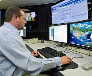 An analyst works at the government's secretive cyber defense lab, Sept. 29, 2011, in Idaho Falls, Idaho. The Homeland Security Department's Control System Security Program facilities are intended to protect the nation's power grid.