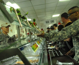 Soldiers are served food at the Raider Cafe Dining Facility at Forward Operating Base Falcon in Baghdad.