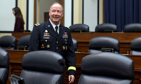 Gen. Keith Alexander, then-Commander of U.S. Cyber Command, arrives to testify before the House Armed Services Subcommittee on Intelligence, Emerging Threats and Capabilities at Capitol Hill in Washington, March 12, 2014.