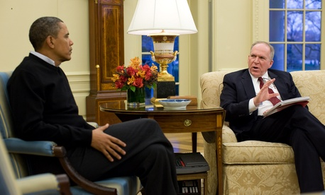 John Brennan briefs the President in the Oval Office.