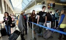 Travelers at Los Angeles International Airport prepare to check in before their flights on Thanksgiving Day 2009.