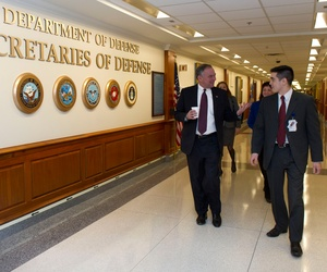 U.S. Sen. Tim Kaine, left, walks down a hall at the Pentagon in Arlington, Va., March 4, 2013. The Virginia senator met with senior military leaders, Department of Defense employees and constituents to discuss the effects of sequestration.