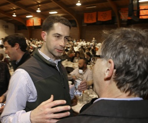 Rep. Tom Cotton speaks to a man at the Gillett Coon Supper in Gillett, Ark., on Jan 11, 2014.