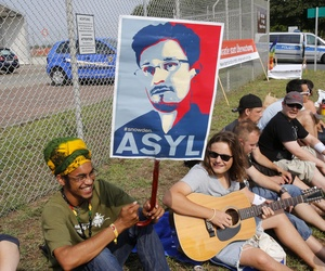 A demonstrator holds a sign asking for asylum for NSA leaker Edward Snowden outside of the Army's 'Dagger Complex' in Griesheim, Germany.